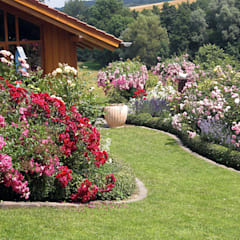 Jardines de estilo rural de Planungsbüro STEFAN LAPORT Rural