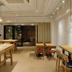 Bun Café - インテリア・カフェ席: MoMo. Co., Ltd.が手掛けたレストランです。