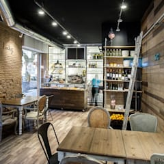 Restaurantes de estilo  por Binomio Estudio