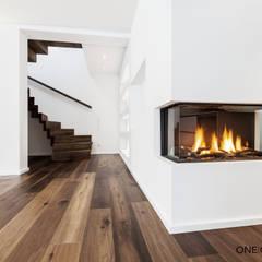 OASE IN DER STADT: moderne Wohnzimmer von ONE!CONTACT - Planungsbüro GmbH