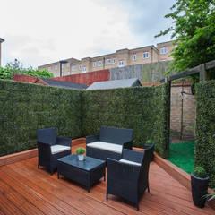 Garden - Canary Wharf:  Garden by Millennium Interior Designers