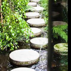 Garden by CRISTINA MAZZUCCHELLI GREEN DESIGN, Eclectic