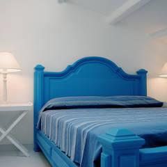 اتاق خواب توسطStudio Guerra Sas