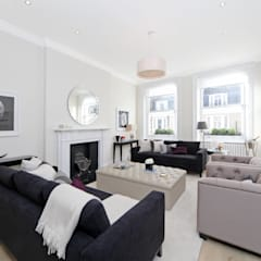 City appartment:  Living room by Hampstead Design Hub