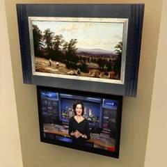 Elegant Décor & Ergonomic TV Solution:  Bathroom by DECOLIFT