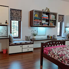 Jaya & Rajesh :  Nursery/kid's room by Cozy Nest Interiors