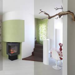 caminetto: Case in stile  di Alessandra Meacci Architetto