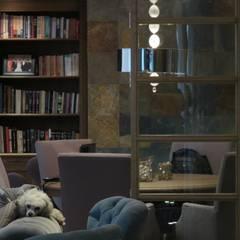 ESS: Salas multimedia de estilo  por NIVEL TRES ARQUITECTURA