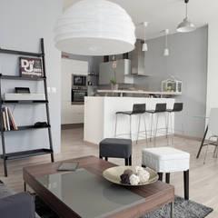 Rénovation Appartement Paris 75003: Salon de style  par Grazia Architecture