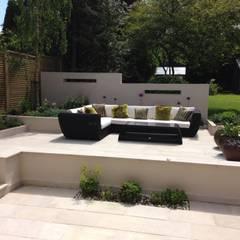 Contemporary Split level terrace:  Garden by Gardenplan Design