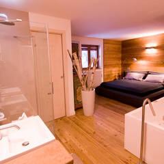Appartamento B+T: Camera da letto in stile  di Architetto Beltrame Claudio
