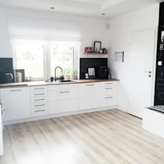 ห้องครัว by White Interior Design