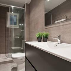 Proyecto Ciutadella: Baños de estilo  de Dröm Living