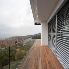 de estilo  por Andrea Vattovani Architecture ZT Gmbh, Moderno
