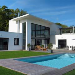 Escale brièronne: Maisons de style  par ATELIER D'ARCHITECTURE ET D'URBANISME MARTIAL