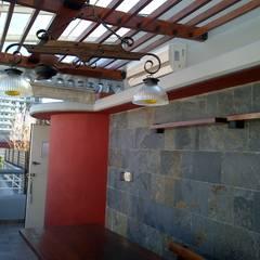 realizacion de quincho en terraza departamento: Terrazas de estilo  por Remodelaciones SF