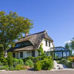 Romantischer Wintergarten: landhausstil Wintergarten von Masson-Wawer Wintergarten GmbH