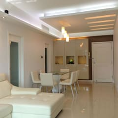 Royal Peninsula Residential Apartment:  Living room by Oui3 International Limited, Modern
