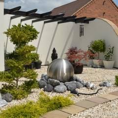 Jardines de estilo  por Unique Landscapes,