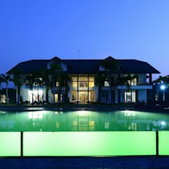 PRIVATE RESIDENCE AT KERALA(CALICUT)INDIA:  Houses by TOPOS+PARTNERS