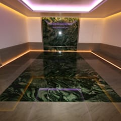 Indoor subterranean pool with movable floor:  Pool by Tanby Swimming Pools