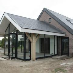 Verbouw stal bij boerderij:  Serre door Architectenbureau Jules Zwijsen,