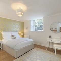 Various Bedrooms:  Bedroom by Saving Graces Interiors
