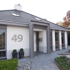 de estilo  por EIKplan architecten BNA, Moderno