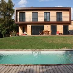 Maison bioclimatique BBC à Montmorency, FR: Maisons de style  par Atelier d'Architecture Marc Lafagne,  architecte dplg