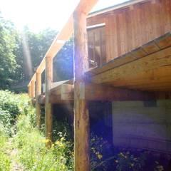 Villa Nature - Jura Suisse: Maisons de style de style eclectique par Mueller Concept