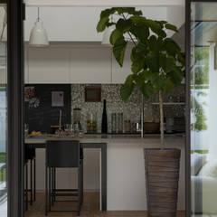 Cocinas de estilo  por Sakurayama-Architect-Design