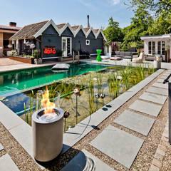 Jar Commerce, Planika : styl , w kategorii Ogród zaprojektowany przez Planika Fires,