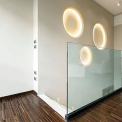 Gimnasios en casa de estilo moderno por studiodonizelli