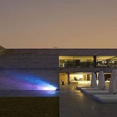 New house in South of England de Sherry Lighting and Design Moderno