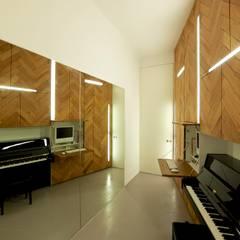 musikzimmer:  Multimedia-Raum von 3rdskin architecture gmbh