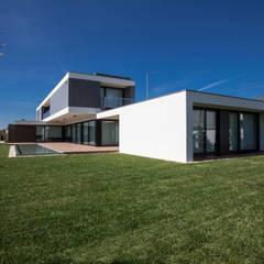 Casa JD: Casas  por Atelier Lopes da Costa,Moderno