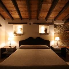 Dormitorios de estilo  de Architetto Giuseppe Prato, Rústico