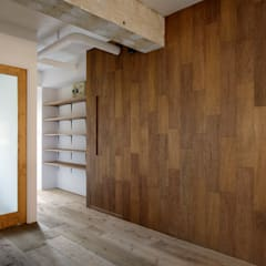 西葛西の住居: 蘆田暢人建築設計事務所 Ashida Architect & Associatesが手掛けた壁です。,ラスティック