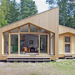Home In The Woods:  Wooden houses by Facit Homes