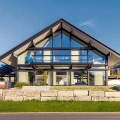 Nowoczesne domy od HUF HAUS GmbH u. Co. KG Nowoczesny