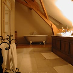 Maison à Bournens: Salle de bains de style  par [GAA] GUENIN Atelier d'Architectures SA