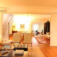 Estar: Salas de estar  por Ornella Lenci Arquitetura