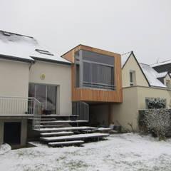 Façade sur jardin: Terrasse de style  par Cécile GAUDOIN Architecte DPLG
