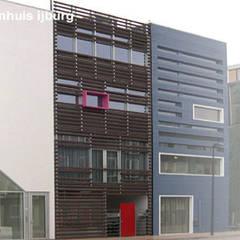 herenhuis IJburg Steigereiland:  Huizen door Florian Eckardt - architectinamsterdam,