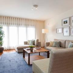 Sala Comum_Zona de Estar: Salas de estar  por Traço Magenta - Design de Interiores