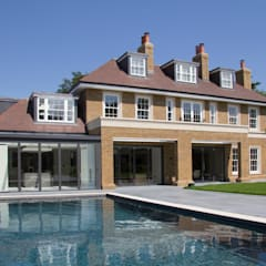 The rear elevation and swimming pool:  Pool by Hale Brown Architects Ltd
