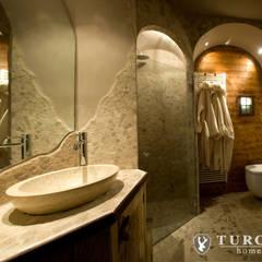 Baños de estilo  por turco home srl