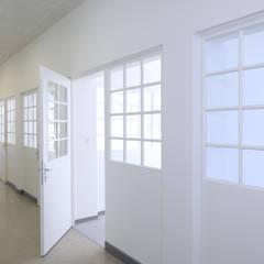 Sanierung und Wiederherstellung historischer Gangverglasungen:  Krankenhäuser von Architekt Adrian Tscherteu