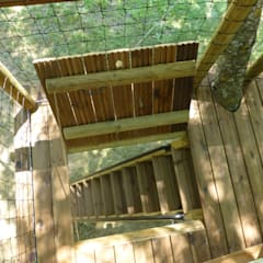 Une jolie petite terrasse a l'ombre des frênes: Jardin de style  par Cabaneo