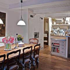 Dining room by Urbana Interiorismo, Rustic